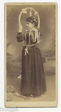 BANNER LADY WITH PISTOL, HOOP, SPOONS, BELLS, TOOLS 1880's-1890's CABINET PHOTO