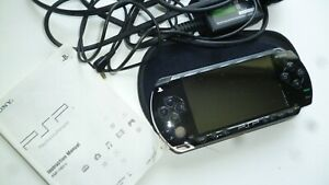 psp handheld games console and charger