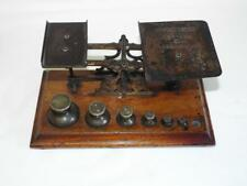 Antique BWB brass postal scales with brass graduated weights.