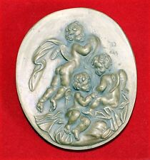 Plaque religieuse en plâtre à décors d'angelots
