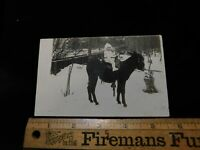 ANTIQUE VINTAGE VICTORIAN  POSTCARD BABY ON DONKEY IN THE SNOW