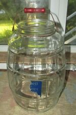 ANTIQUE GLASS BARREL PICKLE JAR WITH RED WOOD HANDLE AND REMNANT OF PAPER LABEL