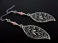 A PAIR OF LONG LEAF THEMED EARRINGS WITH 925 SOLID SILVER HOOKS. NEW..