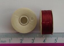 2 reels of red nymo thread, thickness size 'D' (approx 64 yards per reel)