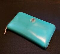 Tory Burch Continental Patent Leather Wallet.