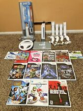 Nintendo Wii Console Bundle - 13 Games + 4 Wii Motes + Light Sabers + More
