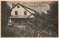 Vintage Postcard 1944 Home and Flower Bed Scene Lined by Pine Trees