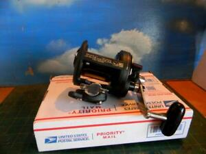 SHIMANO TLD 15 LEVER DRAG  R.H. GRAPHITE FISHING REEL WITH CLAMP-USED