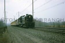 Original slide- PRR Alco powered work extra on a dreary day; 11/1966