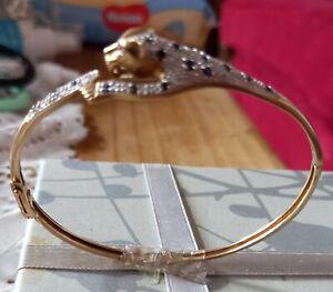 DIAMOND +SAPPHIRE 9ct GOLD LEOPARD BANGLE.