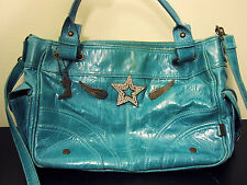 Lollipop turquoise handbag with wings and star