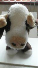 Soft cuddly cow toy