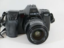 Minolta Maxxum 7000i + Minolta ProMaster Spectrum 7 1:3. 5-4.5 f = 28-70mm Ø 52