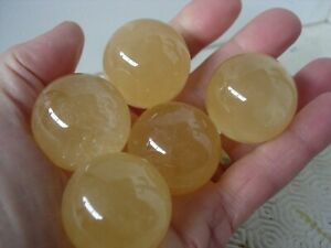 golden calcite spheres set of five 35 mm wholesale including ring stands