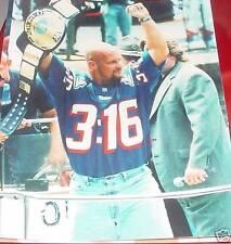 Stone Cold Steve Austin in NE Patriot's jersey 8x10
