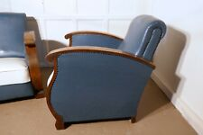 A Stylish pair of French Faux Leather Art Deco Club Armchairs with Walnut Arms