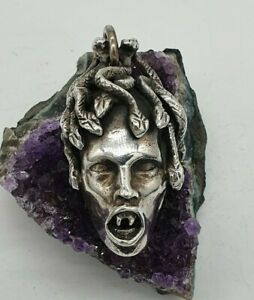 VINTAGE HUGE STERLING SILVER 925 MEDUSA PENDANT BY THE WILDCAT COLLECTION.