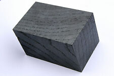 Black bog oak (morta, wood) blocks for pipes from 1270 to 5460 years