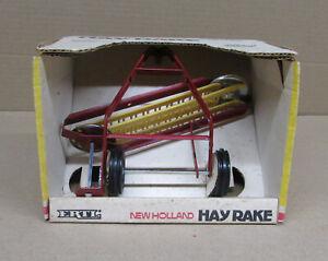 NEW HOLLAND HAY RAKE Old Ertl Farm Toy NIB 1/16 Scale