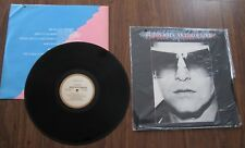 """Elton John - LP - """"Victim Of Love"""" - Canadian pressing - Record is NM; cut-out"""