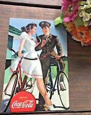 c1999 Vintage Coca Cola Postcard Depicting 1940's Military GI Joe Couple Bicycle