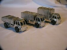 THREE VINTAGE SILVER FRICTION TOY TRUCK