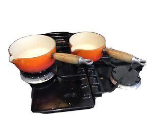 le creuset saucepans orange