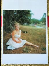 MARILYN MONROE POSTCARD 1957 sitting in white dress in grass