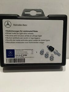 Mercedes Benz Original Teile/ Geprufte  OEM WHEEL LOCK SET IN SILVER