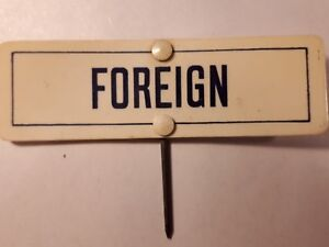 "old vintage shop label ,sign .tag ""foreign"""