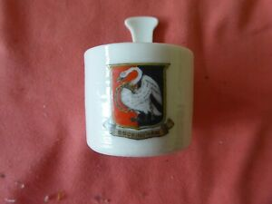 A PIECE OF 'GOSS CRESTED CHINA IN THE FORM OF AN IRISH NOGGIN - BUCKINGHAM