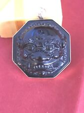 foo dog or shishi in black stone framed in solid 14kt yellow gold