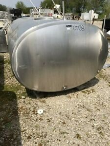 Used approximately 1000 gallon stainless steel vertical tank