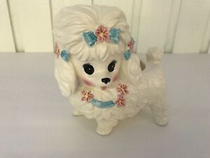 white dog poodle planter with pink flowers