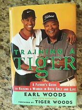 Training a Tiger  signed by Earl Woods  -  JSA
