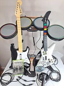 Xbox 360 Rock Band Hero Bundle  2 Guitars Fender + Redoctane  Drums Mic 2 Games