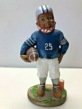AFRICAN- AMERICAN FOOTBALL PLAYER FIGURINE.... 6 IN TALL