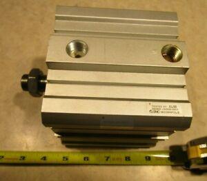SMC NCDQ2B100-50DM COMPACT PNEUMATIC CYLINDER, E0541
