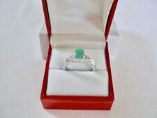 1.08 Ct. Emerald Solitaire & White Topaz  Sterling Silver Ring