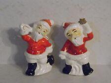 Vintage Japan Ceramic Santa Clause Salt and Pepper Shakers Cane & Star