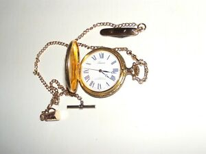 Lucerne Swiss made Pocket watch gold plated with hunter and dogs