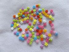 100 plastic buttons. Star shape