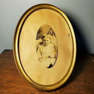"""Antique 19th Century Gold Tin Oval Easel Frame w/ Photo of Child 7"""" x 5"""""""