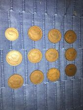 12 georgivs vi d coins. One penny.  Various years decent condition