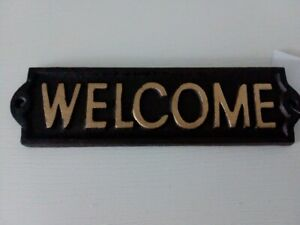 "cast iron  ""WELCOME"" plaque"