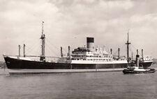 """nice photograph of the ship """"polydorus """" with a tug !"""