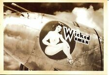 POST CARD OF A WORLD WAR II BOMMER WITH WICKED WOMAN PAINTED ON HER SIDE