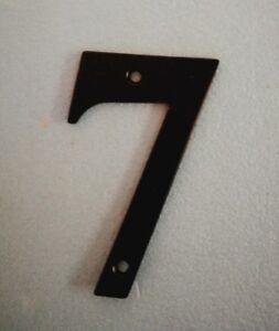 Black metal door number 7.