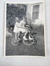 Vintage B&W Photo Two Young Girls Sisters White Dress Riding Big Wheel Tricycle