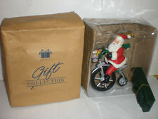 AVON GIFT COLLECTION CYCLING SANTA MUSICAL ORNAMENT  NEW IN BOX